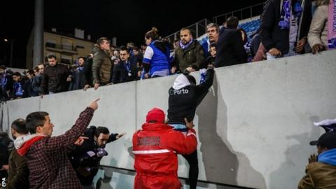 Fans are evacuated from the stand