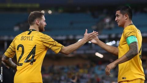 Australia's Martin Boyle and Tim Cahill celebrate