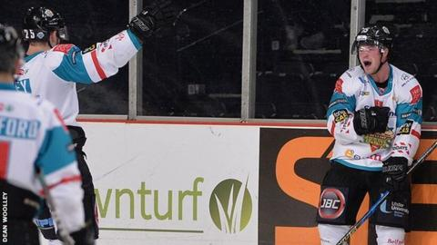 Blair Riley celebrates with Giants scorer Darcy Murphy as he makes it 3-1 against the Steelers