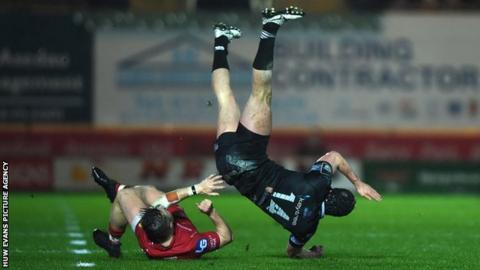Scarlets Steff Evans was red-carded for this aerial challenge on Ospreys Ben John