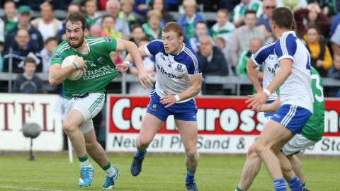 Sean Quigley tries to mount an attack for Fermanagh despite the attention of Colin Walshe