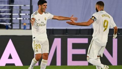 Asensio celebrates with Benzema