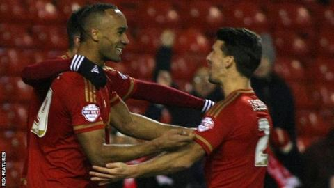 Chris Grady (left) celebrates scoring for Nottingham Forest against Fulham