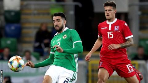 Conor McLaughlin and Seid Korac in action during the first half at Windsor Park