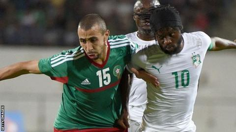 Morocco's Fouad Chafik (left) vies for the ball with the Ivory Coast's Gervinho