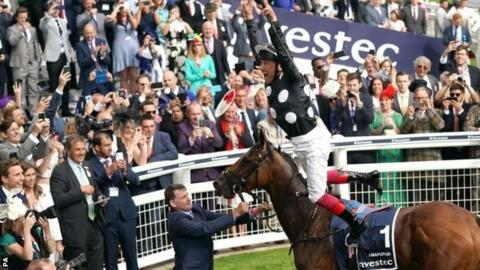Frankie Dettori performs a flying dismount after winning the Oaks at Epsom