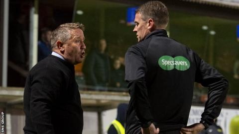 John Robertson was not impressed by fourth official David Lowe