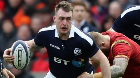 Stuart Hogg runs with the ball for Scotland against Wales