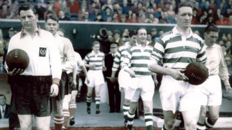 Jock Stein captaining Celtic against Clyde in 1955