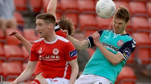 Candystripes defender Niclas Vemmelund heads clear in Friday's clash against St Pat's Athletic