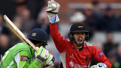Lewis Hill (right) celebrates after stumping Lancashire batsman Haseeb Hameed