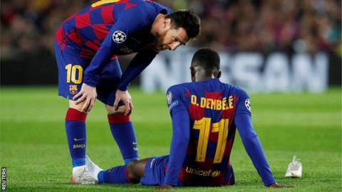 Injured Ousmane Dembele consoled by Lionel Messi