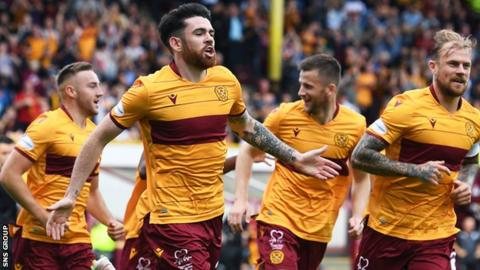Liam Donnelly celebrates shooting Motherwell into an early lead against Celtic