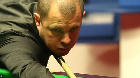 Barry Hawkins plays a shot