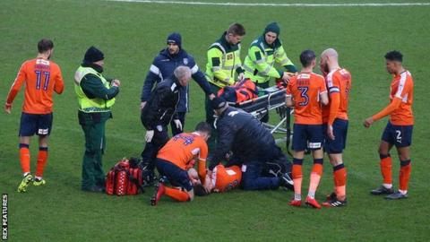 Luke Berry surrounded by paramedics