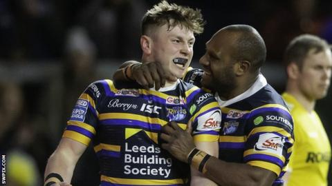 Leeds' Harry Newman celebrates his try against Hull KR with Rob Lui