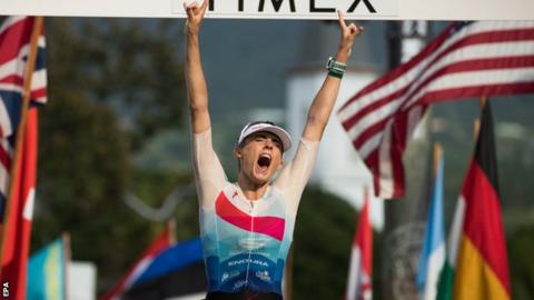 Lucy Charles celebrates on the finish line
