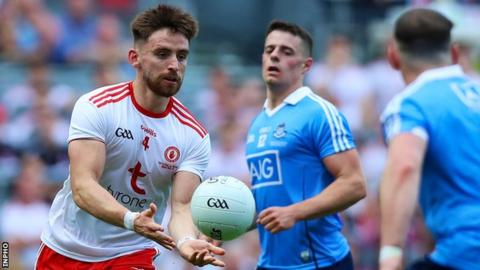 Tyrone's Padraig Hampsey hand passes to a team-mate in this year's All-Ireland Football Final