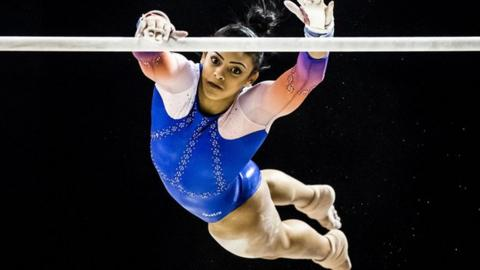 Ellie Downie competes on the uneven bar