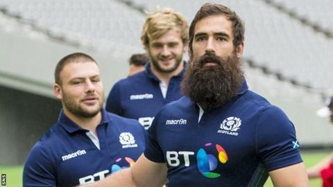 Josh Strauss limbers up in Scotland training at the Tokyo Stadium on Friday