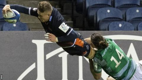 Edinburgh's Darcy Graham is tackled into touch by Tom Arscott of Newcastle Falcons