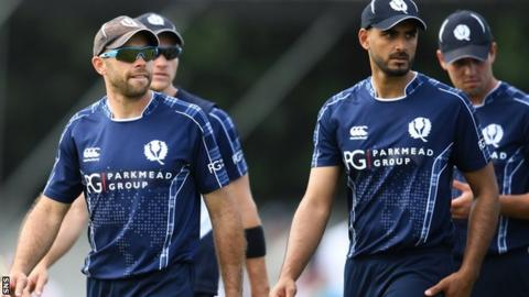 Scotland captain Kyle Coetzer (left) and Safyaan Sharif (second right)