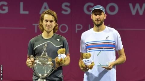 Lukas Lacko with his winners' trophy and runner-up Luca Vanni