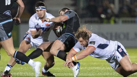 Stuart McInally tackles Fraser Brown