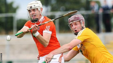 Antrim's Eoghan Campbell battles with Armagh's Declan Coulter at Owenbeg