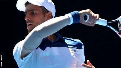 Novak Djokovic playing against Donald Young in the Australian Open