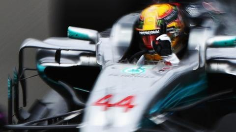 Lewis Hamilton celebrates being quickest in first practice