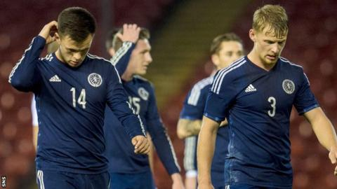 Scotland's Lawrence Shankland and Stephen Kingsley look disappointed