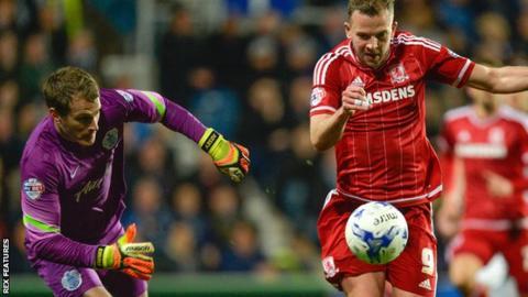 Middlesbrough striker Jordan Rhodes gets past QPR keeper Alex Smithies