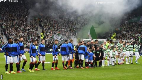 Celtic and Rangers players line up at Hampden