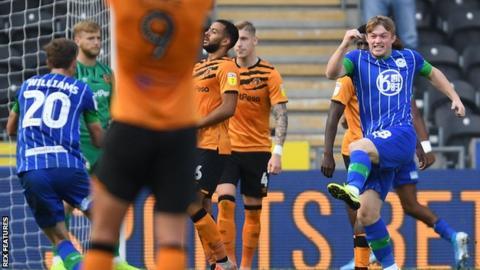 Joe Gelhardt celebrates a goal for Wigan