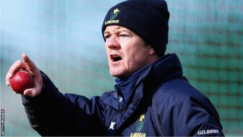 Glamorgan coach Toby Radford makes a point during a net session