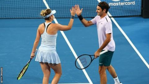 Roger Federer and Belinda Bencic celebrate