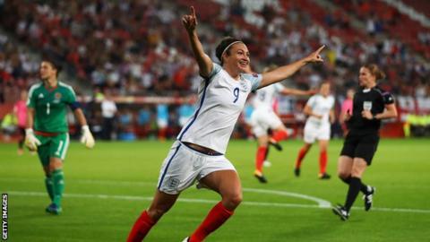Jodie Taylor celebrates scoring a goal