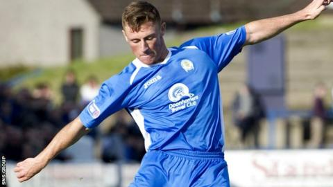 Chris Mitchell in action for Queen of the South