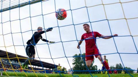 Adam Rooney scores for Aberdeen against Ventspils