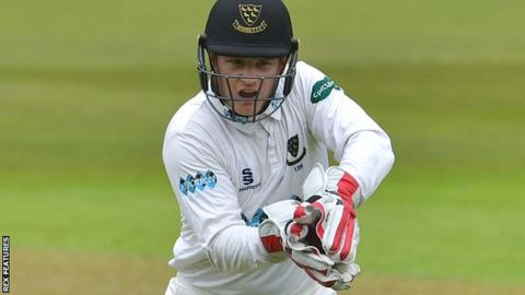 Sussex wicketkeeper Ben Brown gathers the ball