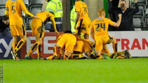 Cambridge United celebrate their late winner