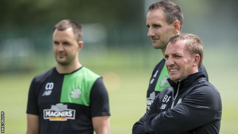 John Kennedy (central) with Brendan Rodgers and Chris Davies (left)