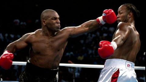 Mike Tyson and Lennox Lewis in 2002