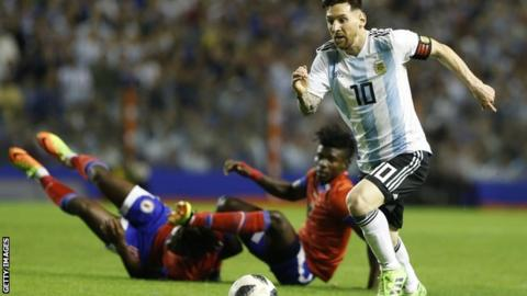 Lionel Messi runs with the ball