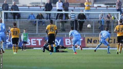 Paul Mullin sends Newport goalkeeper Joe Day the wrong way from the spot