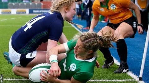 Ireland winger Alison Miller scores her third try in the game against Scotland