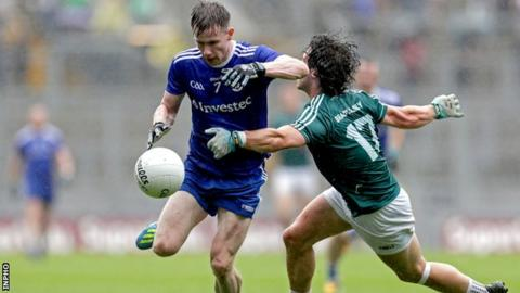 Monaghan's Karl O'Connell is challenged by Kildare substitute Chris Healy