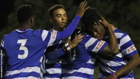Dunstable Town players celebrate a goal
