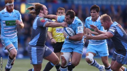 Fraser Brown (centre) of Glasgow holds off the challenge of Kristian Dacey (left) and Rhys Gill (right) of Cardiff Blues